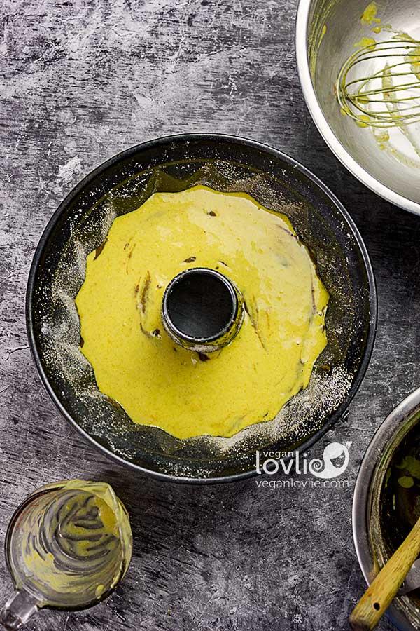Alternating chocolate and orange cake batter in bundt pan