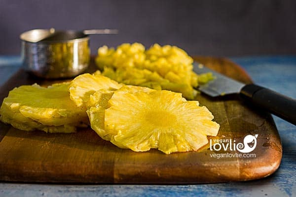 Slices of fresh pineapple on chopping board