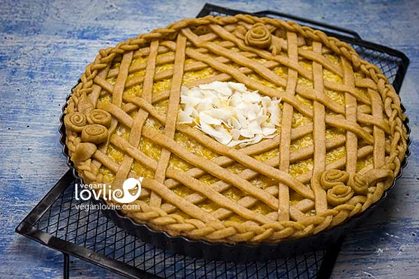 Top centre of pineapple pie with large coconut flakes