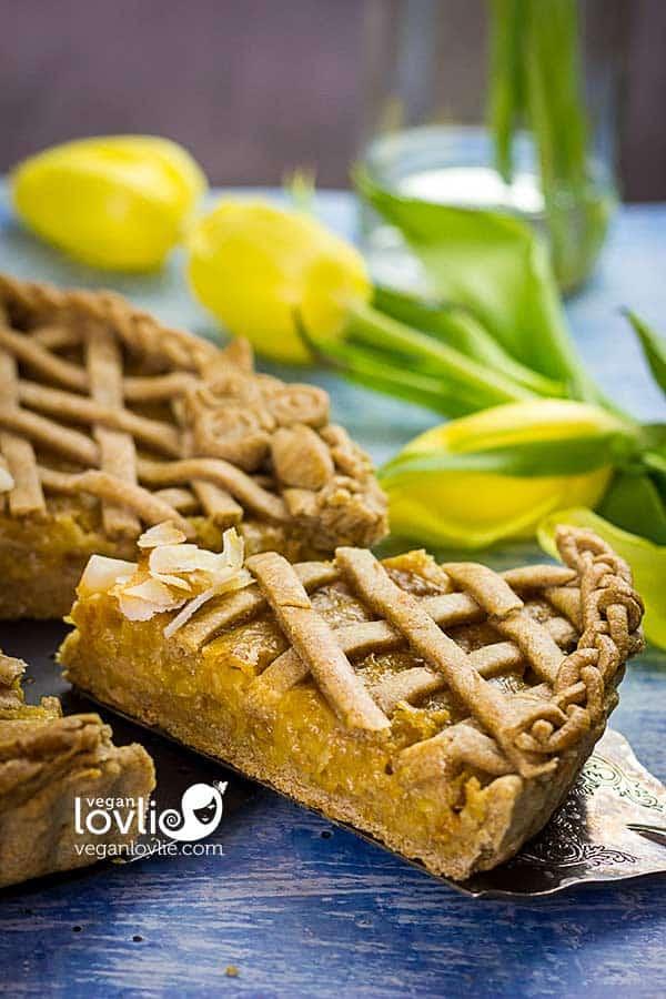 A slice of pineapple pie with pretty lattice design