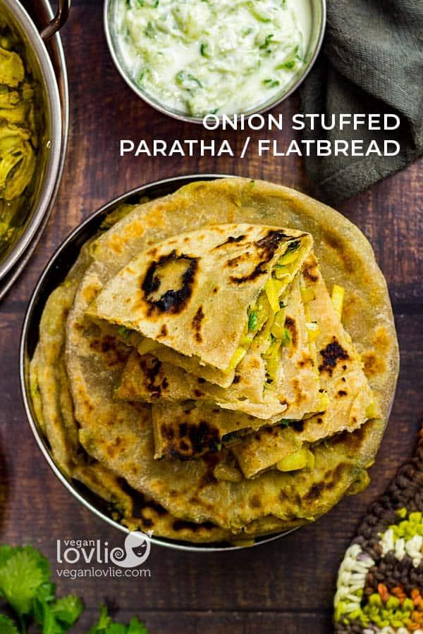Onion stuffed parathas served with jackfruit curry and cucumber raita, stuffed roti/flatbread recipe with caramelized Spanish sweet onions